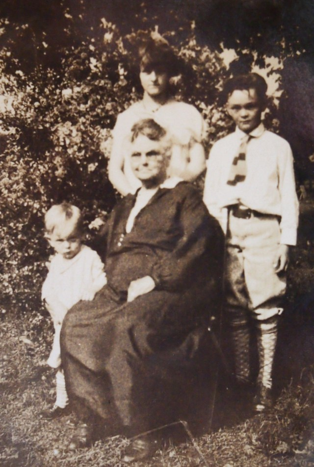 Lester (upper right) with his sister Frances, little brother Wallace, and their grandmother.
