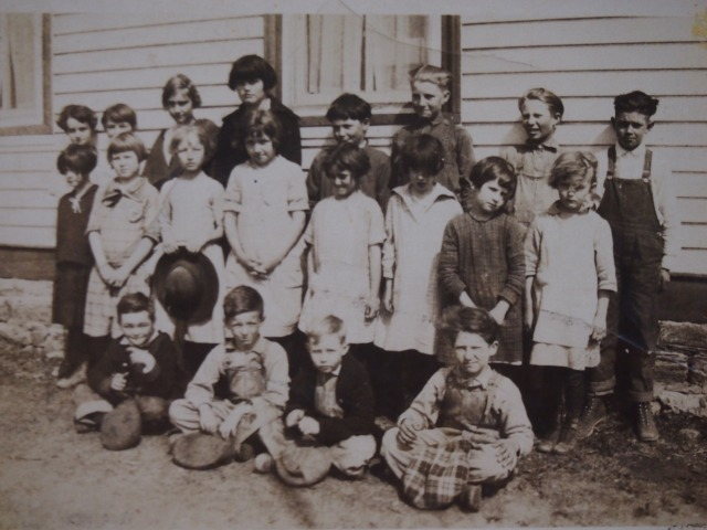 Lester (seated in front on the left) and classmates at District 72 school. Sister Frances is on the back row.
