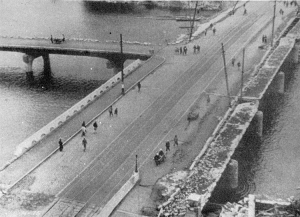 This t-shaped bridge was reportedly the target of the bomb in 1945. Detonation almost directly above the bridge damaged, but did not destroy the structure. It was still usable afterward as this photo shows.