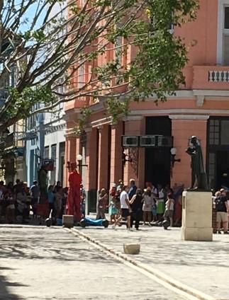 Street drama by actors on stilts